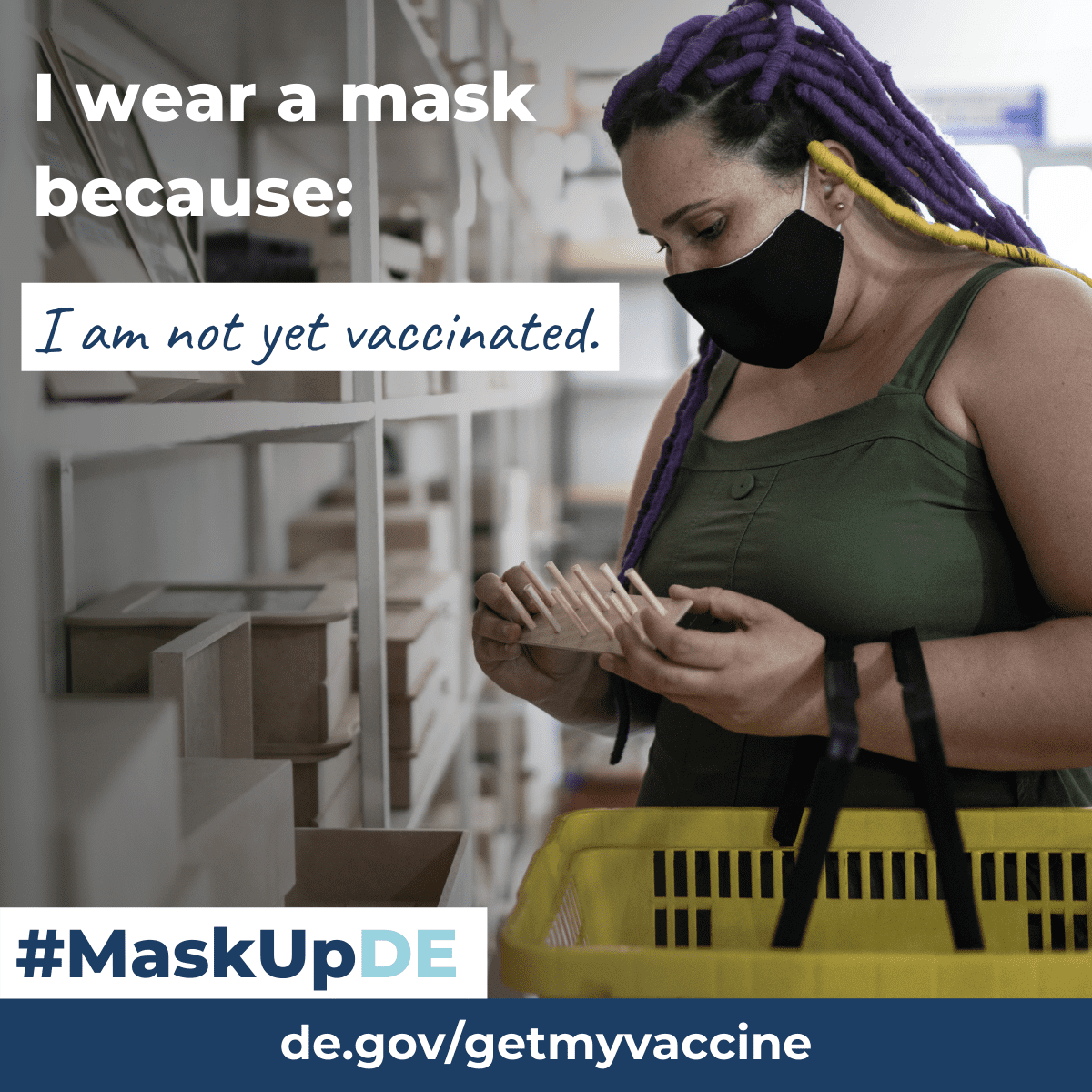 """Woman shopping inside of a store wearing a mask. Graphic element reads: """"I wear a mask because...I am not yet vaccinated."""""""