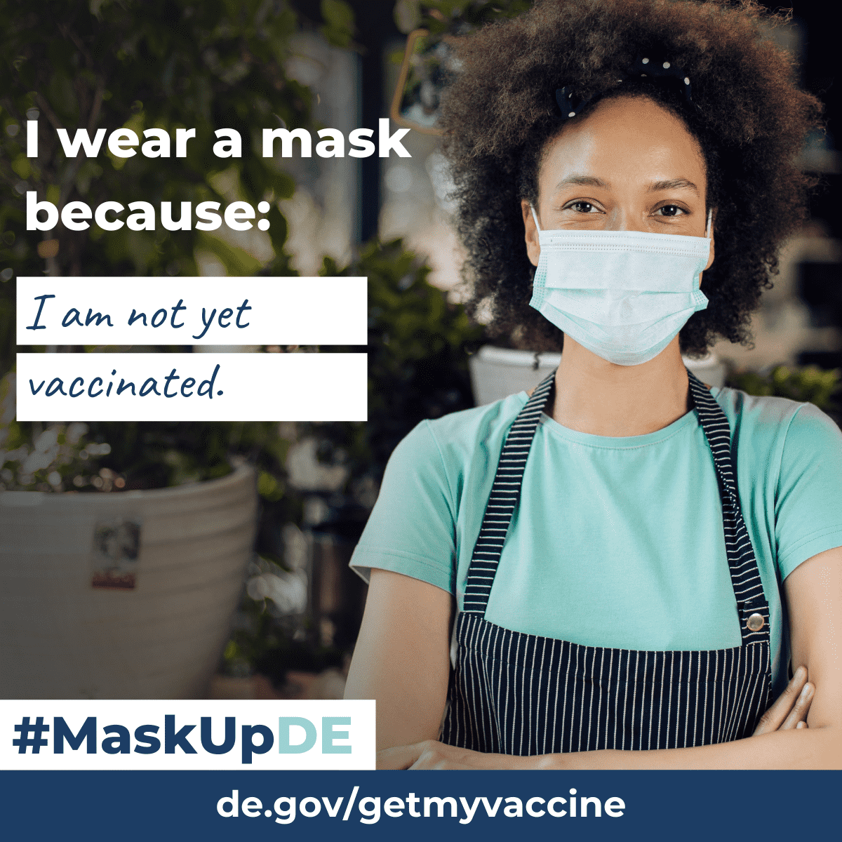 """Woman smiling outside of a market wearing an apron and a face mask. The graphic elements read: """"I wear a mask because...I am not yet vaccinated."""""""