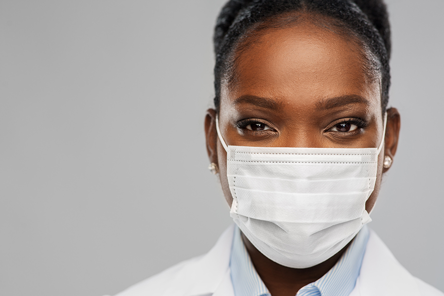 Photo of a female doctor with a mask on.