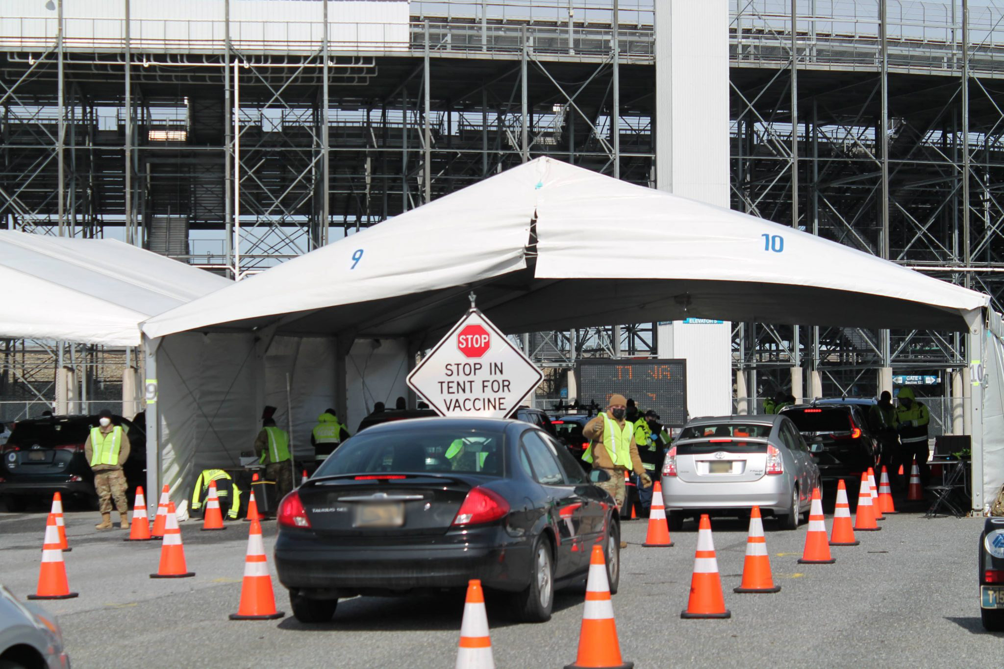 Cars lined up at a Vaccination Event at Dover Speedway
