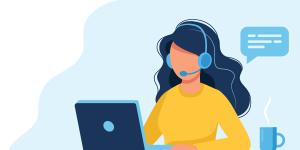 woman at computer desk answering phone calls